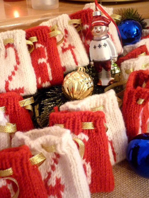 Hand made knitted advent calendar for 24 days, red and white,