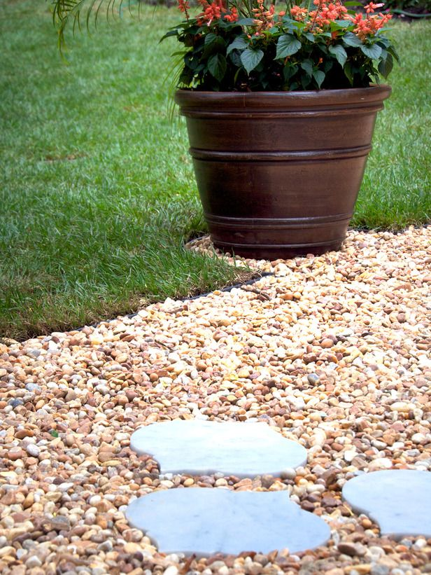 Set a clear path for guests with simple steppingstones. Choose contrasting large stones and small gravel to create extra interest. #summerprojects #DIY