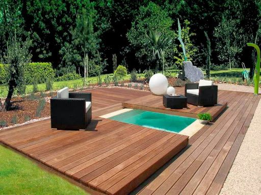 Small swimming pool on backyard with deck