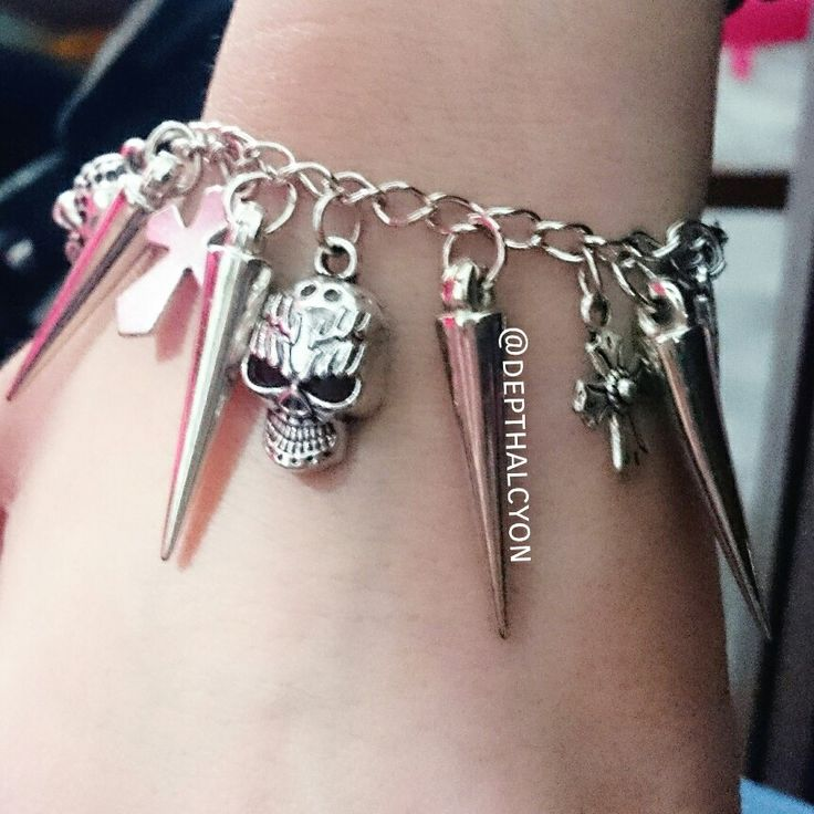 Arm candy  When i can put all of my fave stuffs.. ❤ stud ❤ cross ❤ skull ❤