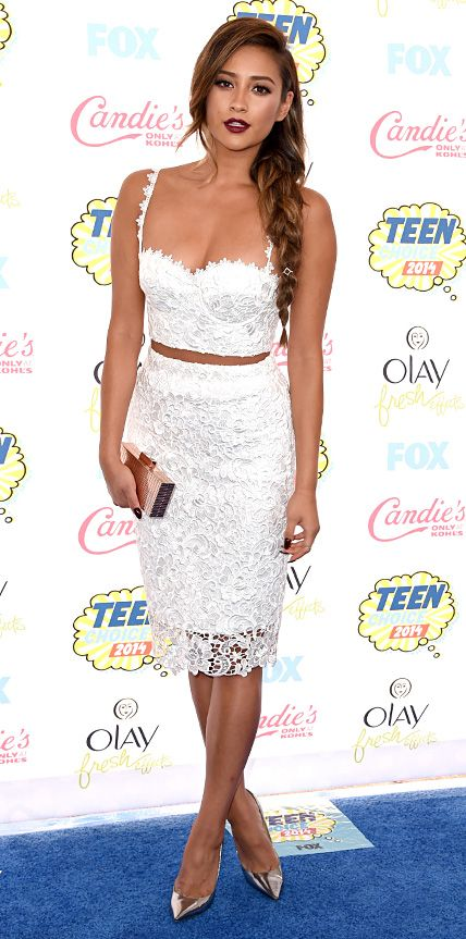 SHAY MITCHELL works two seasonal trends at once: a cropped top and white separates at TCA 2014
