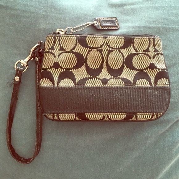 Black and gray Coach wrestler from Coach store Originally gifted from my aunt from a Coach store in Virginia. Very handy- good to fit cell phone, ID cards, money, gum, bike lock, keys, etc. Coach Bags Clutches & Wristlets