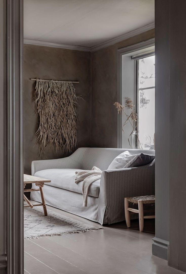 We Love This Moody Yet Neutral Living Room Featuring Limewashed