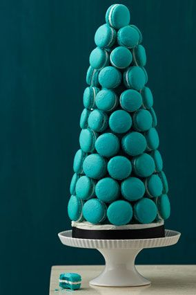 A Macaron Tower would be such a decadent (and edible!) decoration for a holiday party! Plus here's a link to DIY instructions on another site if needed: http://www.projectwedding.com/wedding-ideas/dessert-table-diy-how-to-create-a-macaron-tower