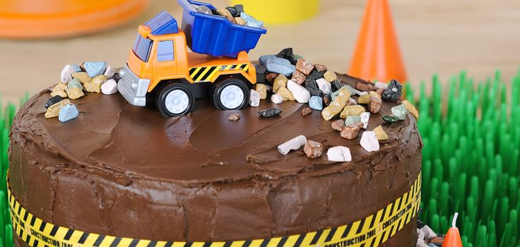 Dump trucks, caution signs, traffic cones – we covered the basics of a construction-themed birthday party, then added extras to bring the work zone to...
