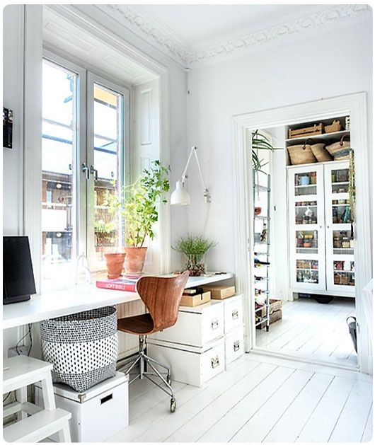 I also like the whiteness of this room. It includes lovely details, but they are not highlighted, so provide interesting background. I also like the idea of a 2 room (or more?) workroom.    From: The Bottom of the Ironing Basket - http://thebottomoftheironingbasket.blogspot.com/2012/07/in-search-of-perfect-workspace.html