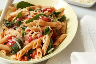 Spinach-Pasta Toss recipe - Spinach. Tomatoes. Cheese. Penne pasta. With ingredients this good, you don't need much else! (Bonus: This only takes 25 minutes to make, start to finish.) #backtoschool