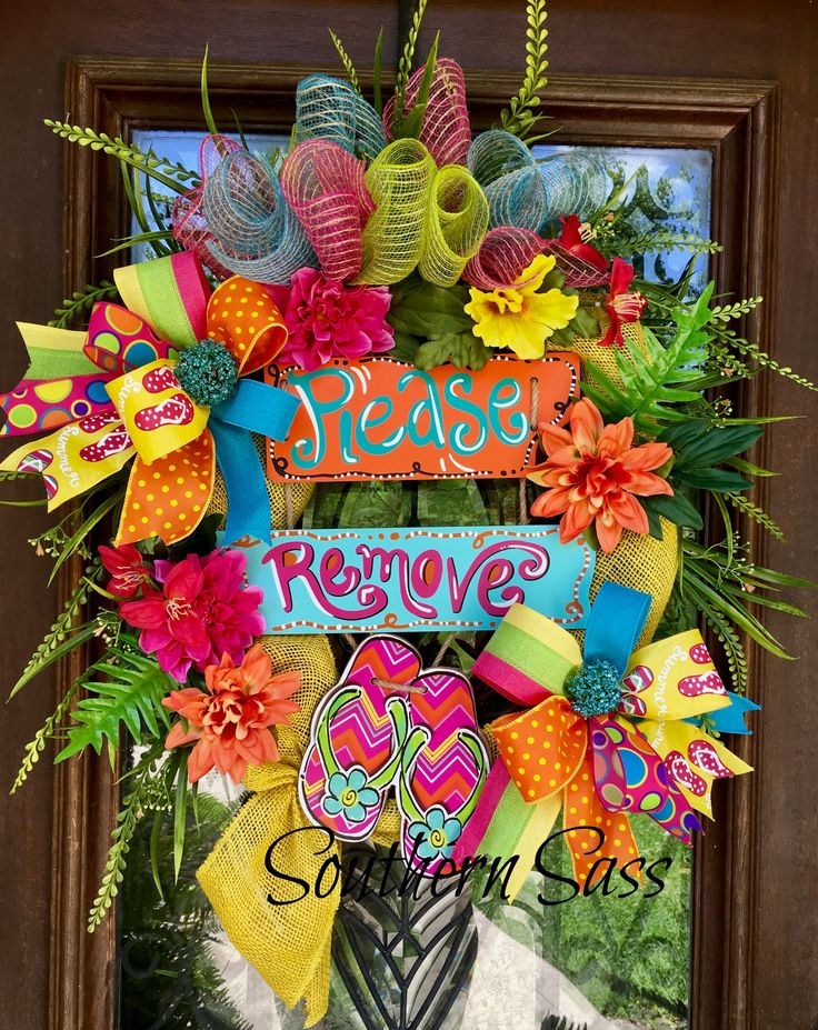Large and loaded floral flip flop wreath. Perfect for summer and popping with color. www.facebook.com/groups/southernsass wreaths
