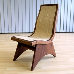 ergonomic chair in cedar and whicker