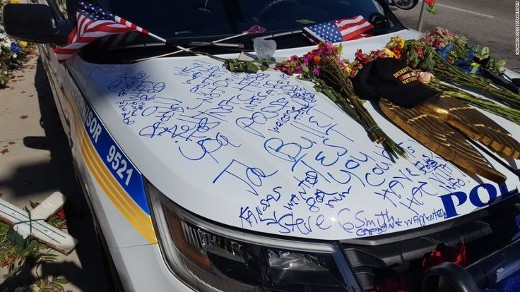 Just one day after her alleged killer appeared in court, Lt. Debra Clayton's squad car was defaced as it sat outside Orlando Police Department headquarters in memoriam.