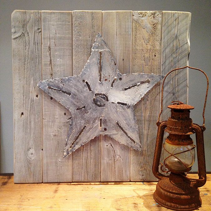 Salvaged #wood and a #rustic metal star were all we needed for a little whitewashed wall art.