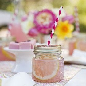 Keep guests cool at a country or cottage themed wedding by serving lemonade from these Mason jars that have decorative perforated lids