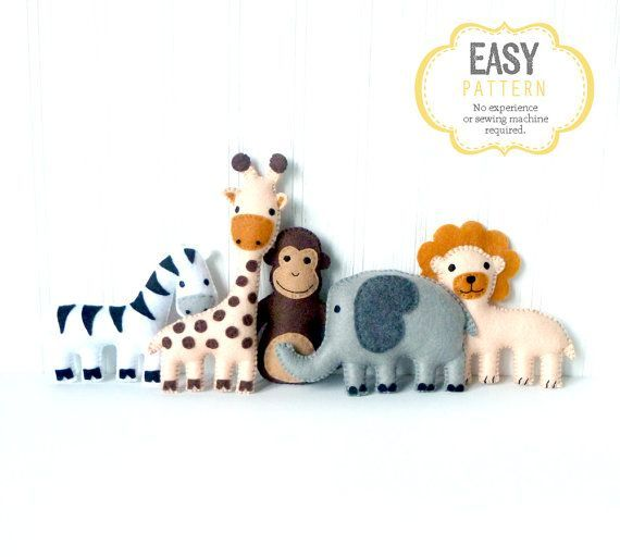 Patterns and instructions to make five mini safari themed stuffed animals using felt and hand embroidery: an elephant, a giraffe, a monkey, a zebra, and a lion. If you're looking to decorate a nursery or make a jungle mobile, these felt critters are a great resource!