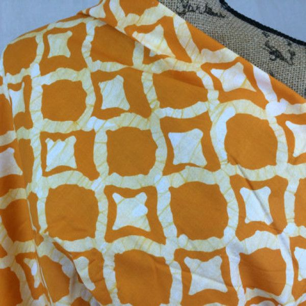 hand-dyed-in-ghana-african-batik-print-fabric-fair-trade-fabric-orange-and-pale-yellow-ikat-print-african-fabric-by-the-half-yard-1.jpg