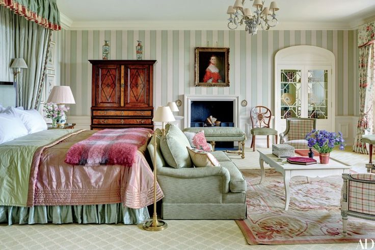 In an apartment revived by designer Mark Gillette, on a 300-year-old English country estate, the guest room is sheathed in a Colefax and Fowler wallpaper   archdigest.com