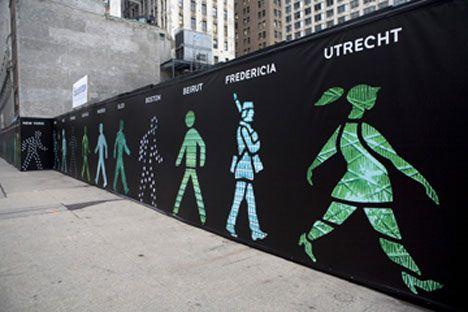 Walk This Way: 99 Diverse 'Walking Man' Figures in Manhattan