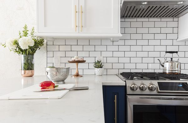 We chose a traditional subway tile backsplash with dark grout, and a gorgeous white quartz countertop that mimicked the veining of Carrara marble without the porousness. (Thanks to Halina and my husband, Chris, for talking me out of sparkly, recycled glass quartz with specks of glitter.)