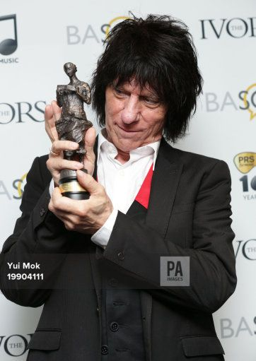 Jeff Beck with his Outstanding Contribution to British Music award, at the 59th annual Ivor Novello Awards, at Grosvenor House, London. 22-May-2014