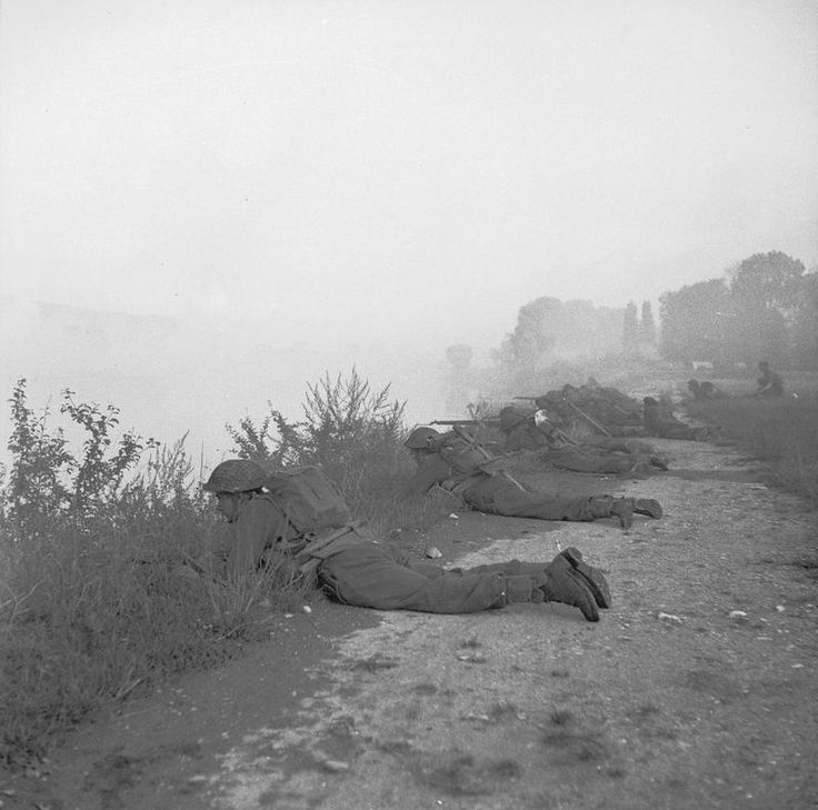 Crossing the Seine and the advance to the Siegfried Line 24 August - December 1944: British soldiers lie on the banks of the Seine, giving their comrades covering fire during the crossing of the river near Vernon.