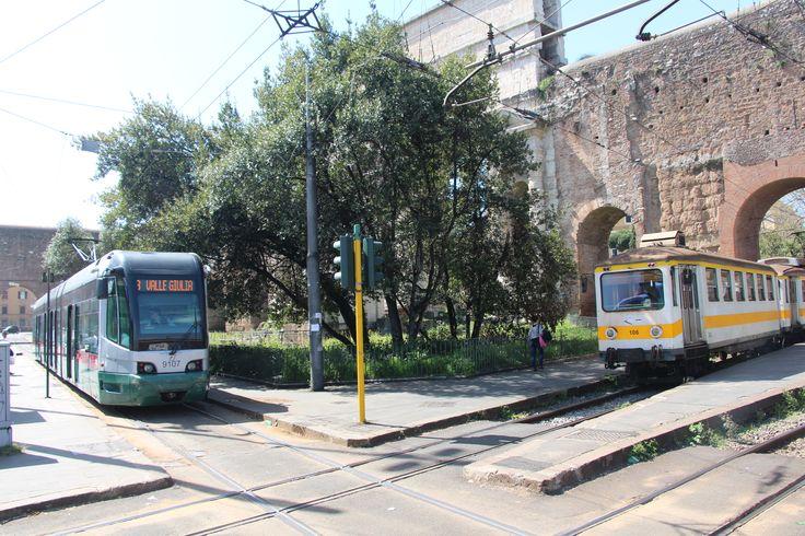 A Roma 1 Tram and a narrow-gauge train intersect at Porta Maggiore in Rome. #tram #train #narrowgauge #rail #roma