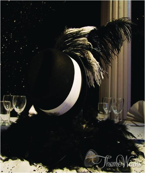 When creating a themed party 'Office Christmas' thinks about every aspect from the right style of dance floor to unique centre pieces. For the 1920's theme we have used a gangster style hat incorporating feathers pieces.