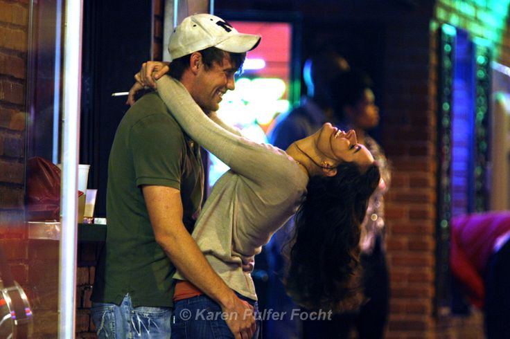 Paige Wilkerson of Lakeland and Lance Sneed of Bartlett, Tennessee didn't need any mistletoe to celebrate. About 1am along Beale Street, couple stroll, neck , dance and bar hop with little care about the time of night.   ©Karen Pulfer Focht