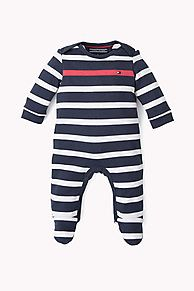 Pure cotton one-piece striped bodysuit with an accent-coloured stripe across the chest. Snap fasteners along inside leg for easy nappy changes. Tommy Hilfiger flag on chest.