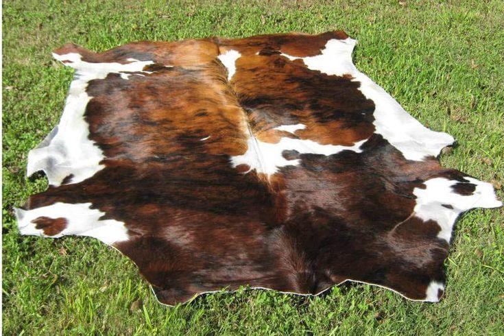 Western Decor COWHIDE Rug Leather BRINDLE Brown. $155.00, via Etsy.
