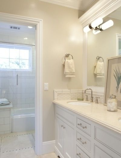 White: Ben Moore Berber White  Best Paint Colors For Interiors. Like the lighting and the tile trim too. Cool crown moulding trim idea on top of mirror