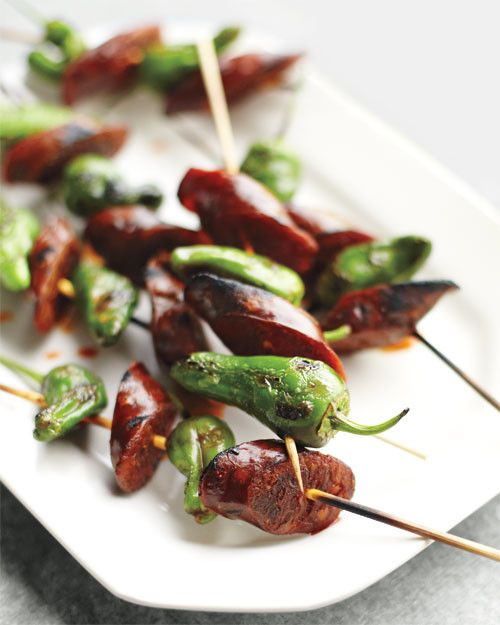 Take tapas to the grill with smoky chorizo skewered with spicy Spanish peppers.