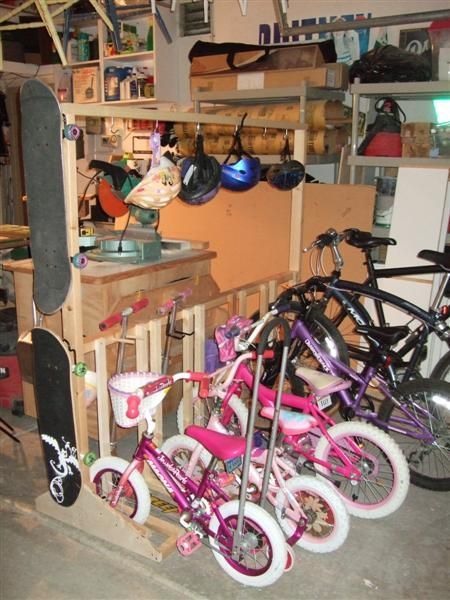 Bike, scooter, and helmet storage! - - Clear off the front porch, then build this thing at the back!