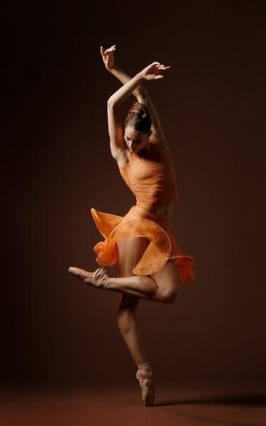 "Beautiful ballet dancer in tangerine two-piece tango-esque costume… Pose reminds me of ""Esmerelda"" or ""Raymonda""…"
