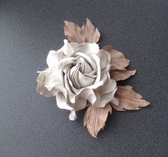 This flower brooch is made from high quality colored natural leather. The material is specially treated to preserve the form of the accessory