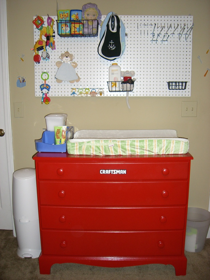 "Tool themed boy's room - peg board for storage and a ""Craftsman"" dresser/changing table.  Bought the Craftsman plate online and glued it to the dresser, which we painted red."