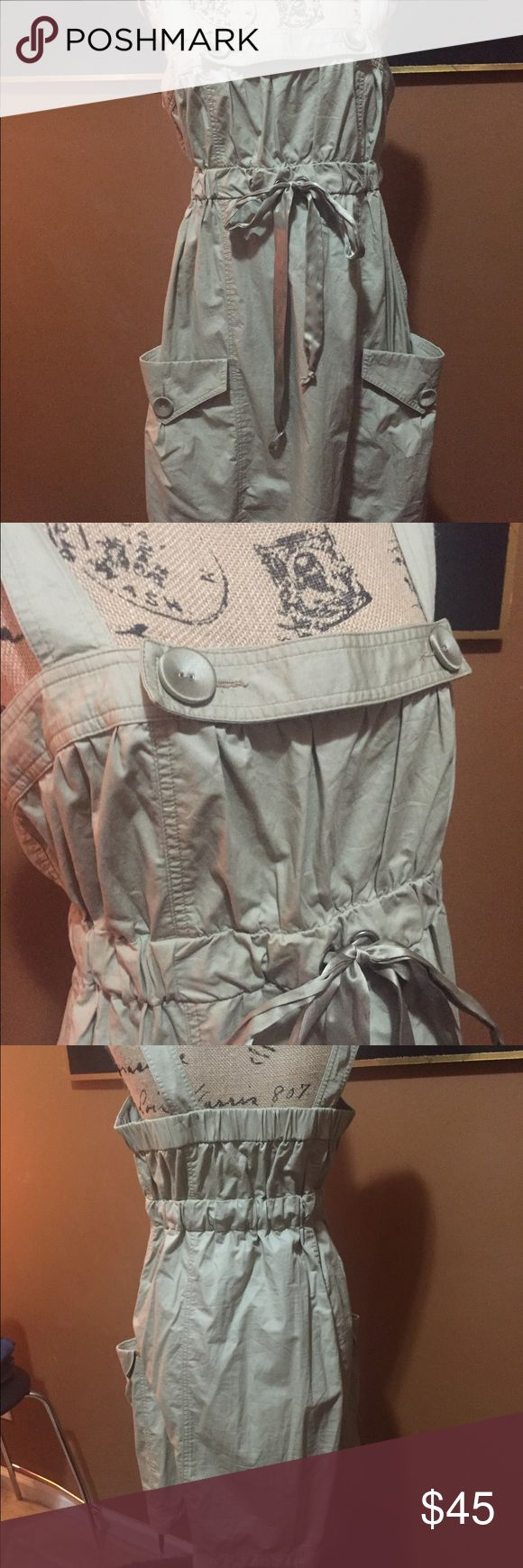 NANETTE LAPORE jumpsuit dress This is a cute khaki jumpsuit style dress with satin drawstrings at bust and hem line. Large buttons on each pocket.   Pair it with a t-shirt or bandeau.   Make an offer!   It is NWOT!  Never got to wear it! Nanette Lepore Dresses Midi