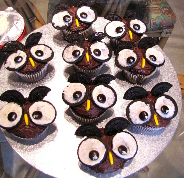 Owl Halloween Cupcakes.... Use Oreo cookies for eyes and ears, Smarties or M's for the inside of the eyes, and the banana candy for the beak! :) Fast and easy! I made these for Halloween 2010! :)