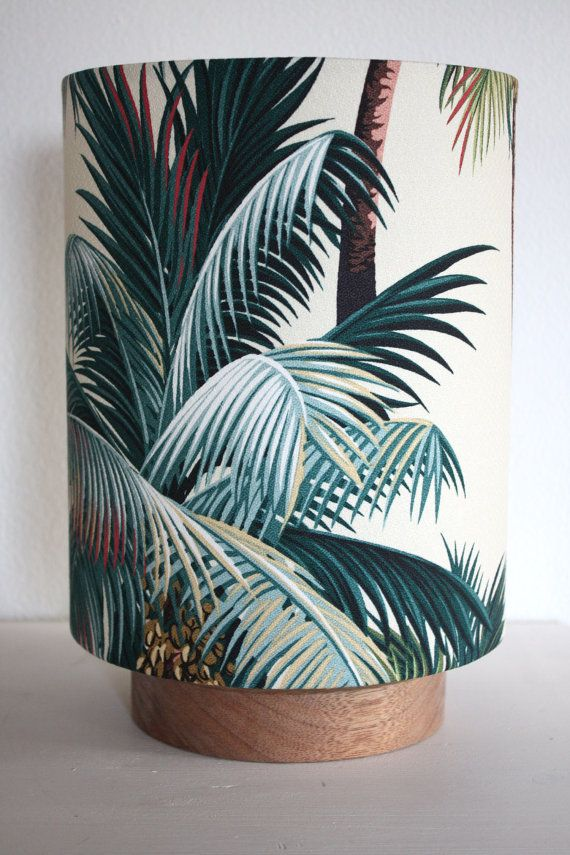 My line of circle lamps with round wooden bases made in maple and coated with linseed oil to bring out the colour. This pairing is my best loved barkcloth design, the palm tree on an ivory background, spills light from the bottom creating a circle of light , hence the name. This lamp is my smaller version which measures w20cmx h30cm (6x12) and is wired to Australian Standards. Come and see my complete range at my online store www.homeworksdesignstore.com
