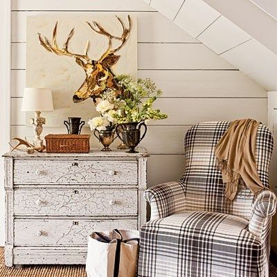 love this deer head art, the flannel chair, and that shabby chic dresser agains those paneled walls. Such a cozy cottage look!