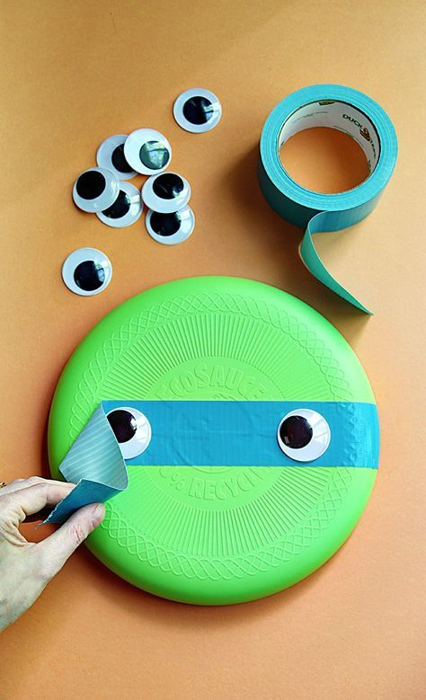 Need a new twist on summer play activities and craft ideas? Upgrade a green Frisbee with duct tape and googly eyes, then throw it like a ninja turtle! We pulled our inspiration from the Teenage Mutant Ninja Turtles: Out of the Shadows movie, in theaters June 3rd! #ad
