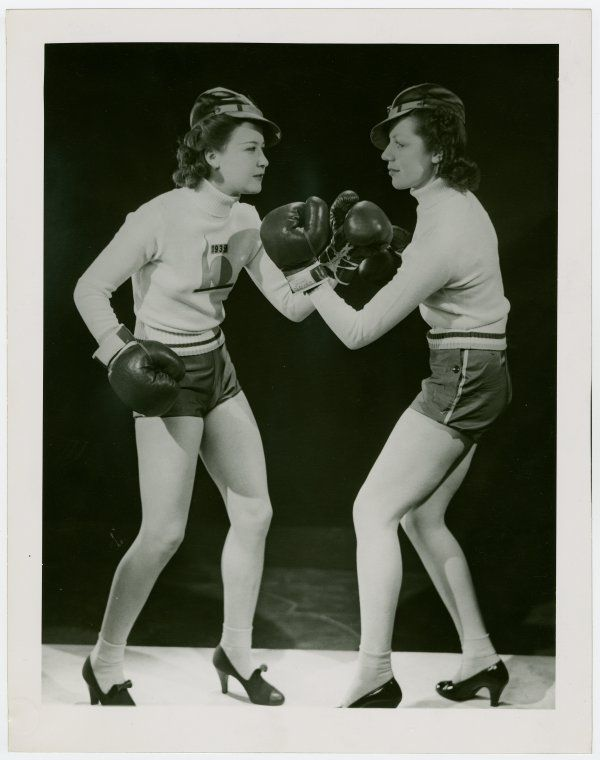 Women boxing in heels.