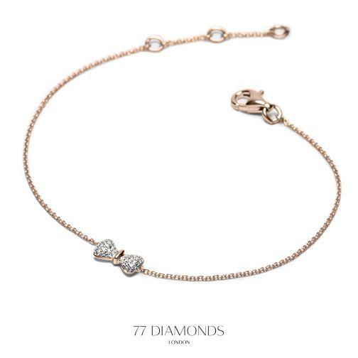 A charming, dainty diamond set bow on a dainty chain.