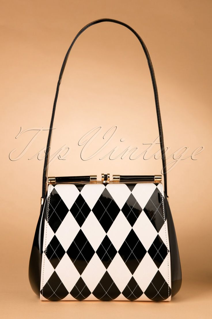 """Elegant, edgy, playful... this 50s Eleanor Lacquer Handbaghas it all!This gorgeous bag has a nice shape and is made from elegant 'faux' patent leather with diamant check pattern in black/cream and a unique closure. Better put this beauty on your wish list, because this winter will be """"Classy Chic""""! ;-)   Gold toned closure 2 open compartments with zip pocket between Three additional small side pockets, one with zipper Lined with black satin Adjustable strap due ..."""