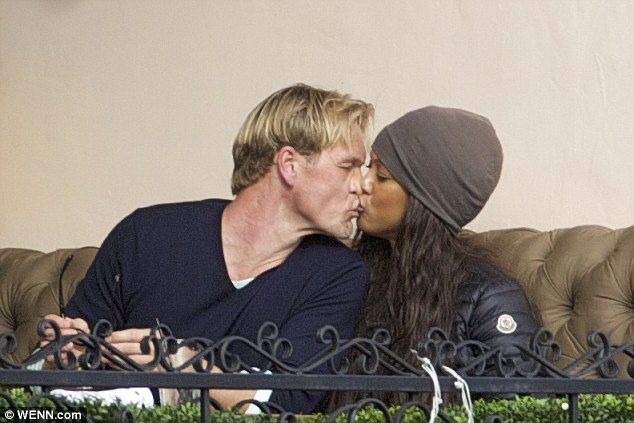 Model date: Tyra Banks and boyfriend Erik Asla shared a romantic kiss while having lunch on Friday