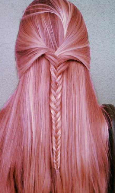 Pink pastel hair with a fishtail braid (mermaid hair for sure!)