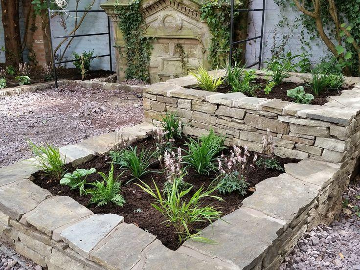 Garden Design & Planting #raisedbed #stoneraisedbed #cheshirestone #stonegardenfeature #arbour #plantsforshade #ferns #hakonechloa #tiarella #brunnera #liriope #englishgarden #victoriangarden #gardendesigncheshire #plantingdesigncheshire