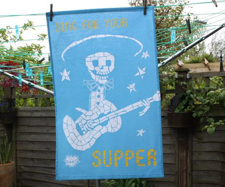 SING FOR YOUR SUPPER A fun tea towel to brighten up your kitchen.  Skeleton playing the guitar  100% Cotton
