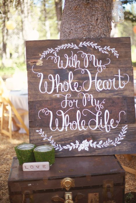 Quotes on a wooden backdrop with bold white script - perfect for an outdoor ceremony. Source: Ruffled blog. #woodensigns #outdoorweddings