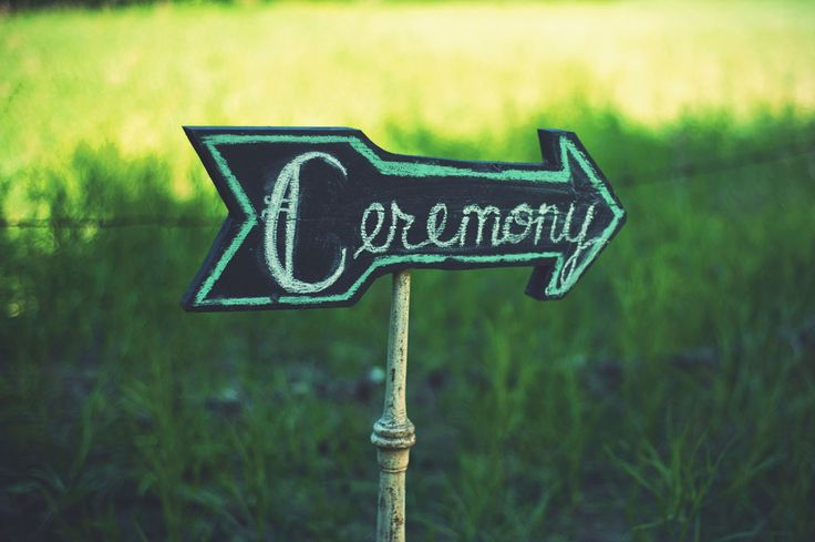 Ceremony, chalkboard, sign, arrow, bohemian wedding, outdoor wedding, wedding details.  Ashley + Devon's Whimsical Boho Wedding | Kismet & Clover {http://kismetandclover.com}
