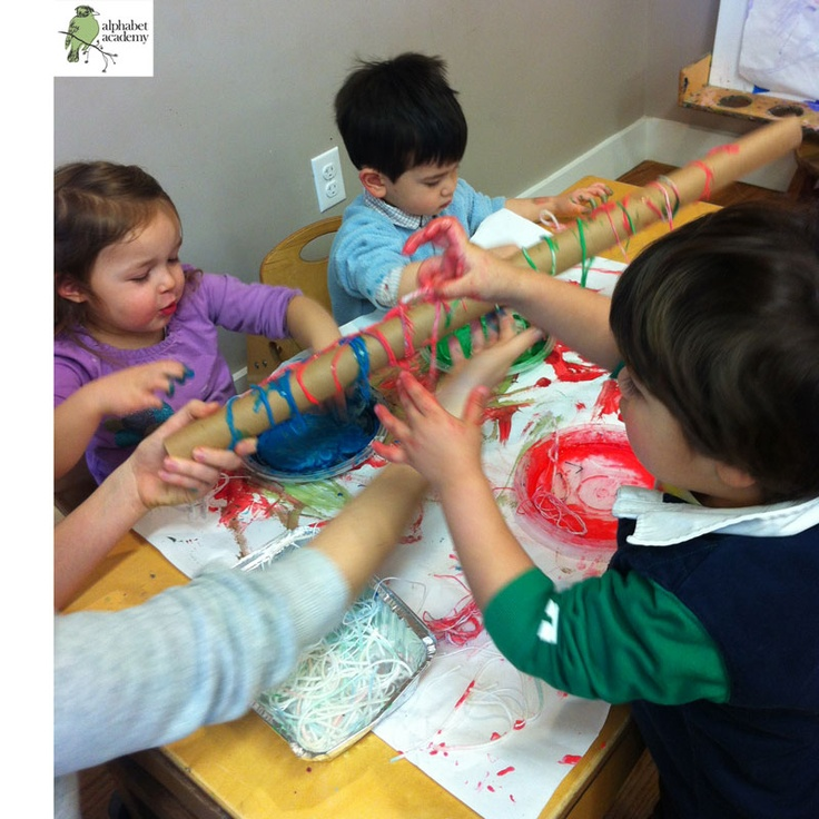 Fun sensory activity! Mix food coloring and glue. Dip and swirl string and yarn into it, then drape the string and yarn around cardboard tubes!