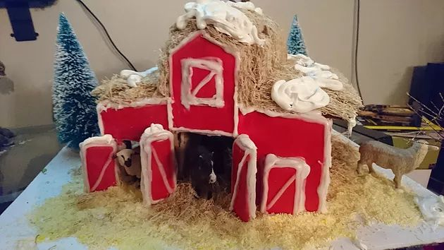 This year we decided to make a barn instead of a house for our gingerbread creation.To check out our Gingerbread recipe, and our icing recipe
